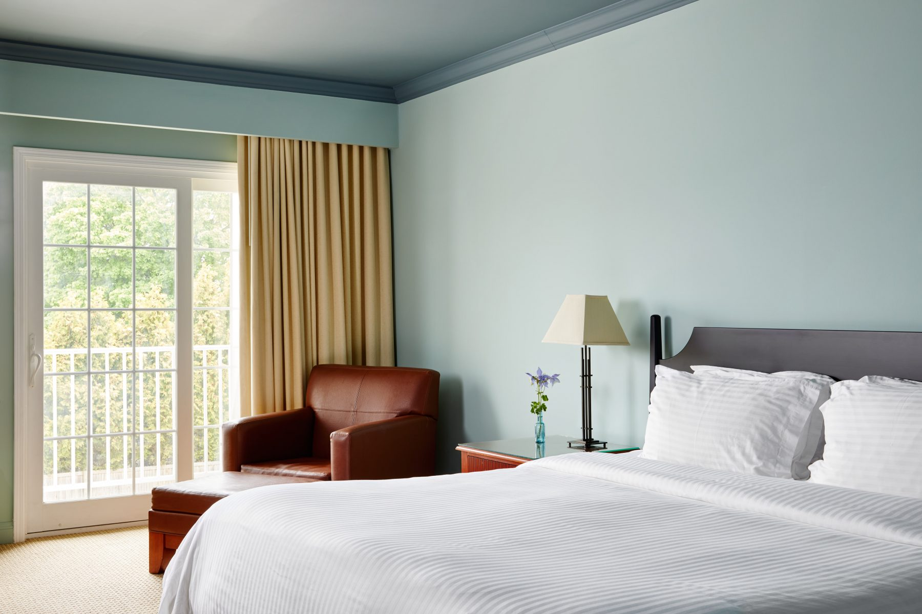 King bed suite with open window of the balcony
