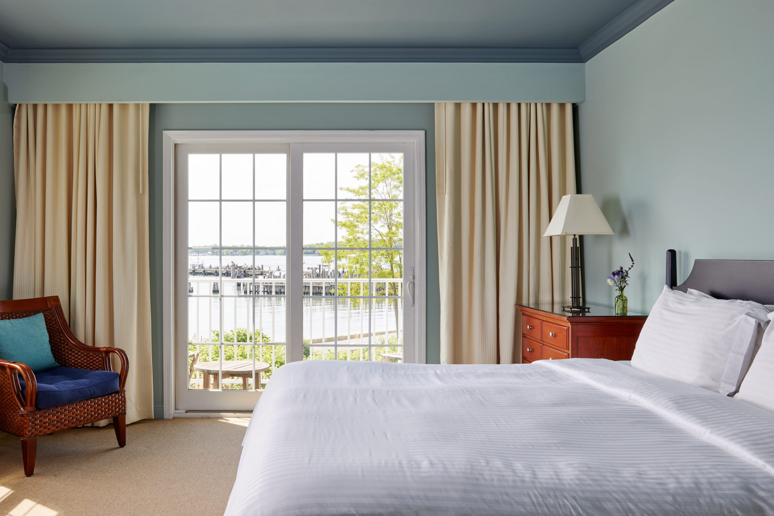Junior suite with open windows and view of the water